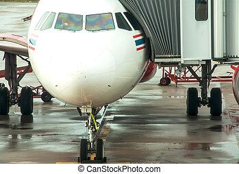 Aircraft ready - aerobridge in plane parked at Udon Thani...