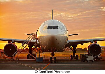 Aircraft service - large aircraft at the beautiful sunrise