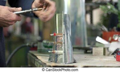 Aircraft sheet metal fasteners. Hands of worker, aluminum...