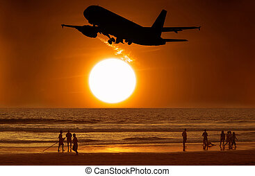 Aircraft take off and the sunset and people on the beach