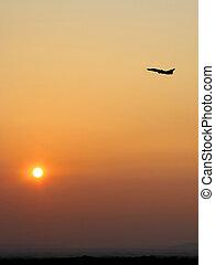 Aircraft takeoff at sunset