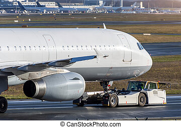 Aircraft towing airport, for service maintenance in the hangar.