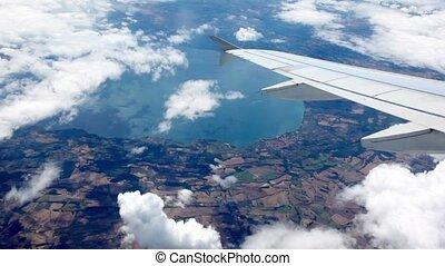 Aircraft turn at flight over sea shore