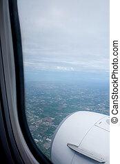 Aircraft window onto jet engine
