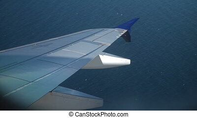 Aircraft wing above water surface