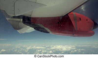 Aircraft Wing and a Blue Sky View from a Plane