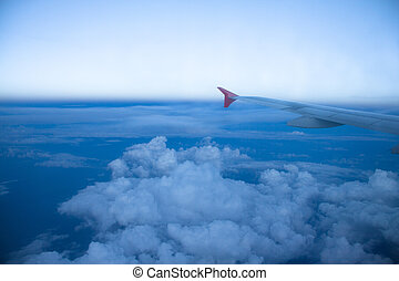 Aircraft Wing on blue sky background
