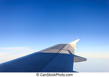 aircraft Wing on blue sky