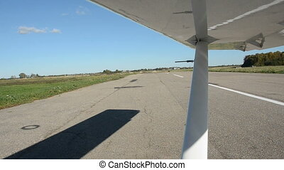 aircraft wing vibration and shadow on the aerodrome