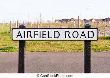 Airfield road sign on a wooden post