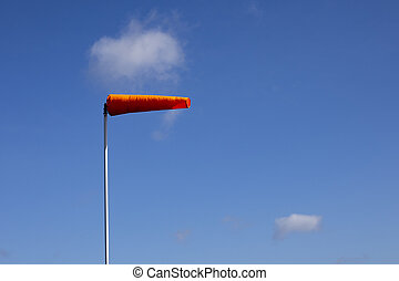 Airfield windsock, used to indicate wind speed and...