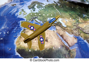Photo of a Generic Toy Fighter Jet Elevated Above a Map.