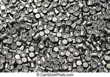 airgun pellets background - numerous airgun lead pellets as...