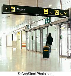 Airline Passenger - An airline passenger inside an airport.