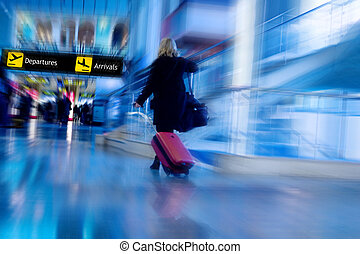 Airline Passenger Rushing in the Airport Terminal