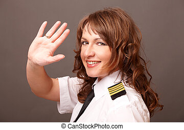 Airline pilot - Beautiful woman pilot wearing uniform with...