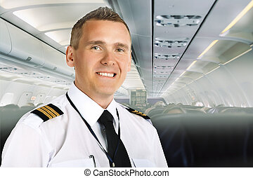 Airline pilot on board - Airline pilot wearing uniform with...