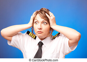 Airline pilot - Worried woman pilot wearing uniform with...