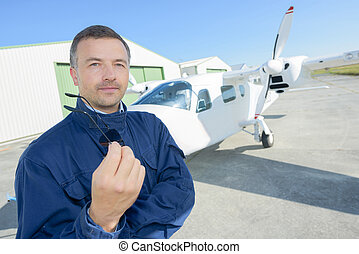 airline pilot standing near aircraft