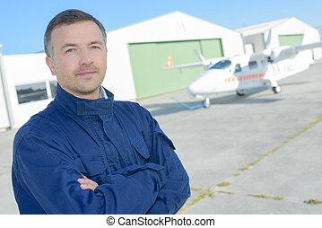 airline pilot standing near aircraft