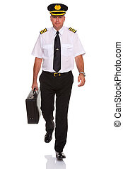 Airline pilot walking carrying flight case. - Photo of an...