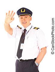 Airline pilot waving - Cheerful airline pilot wearing ...