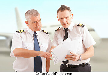 Airline pilots at the airport - Airline pilots wearing ...