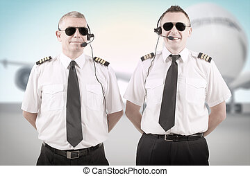 Airline pilots - Cheerful airline pilots wearing uniforms ...