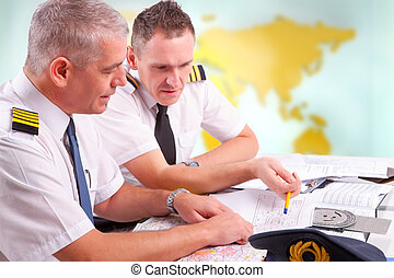 Airline pilots filling in papers in ARO - Two airline pilots...
