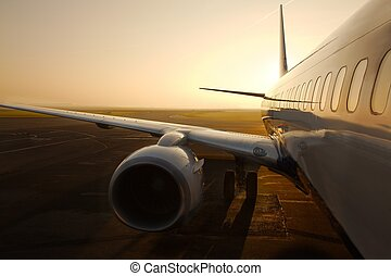 Airliner - Airplane at an airport at sunrise