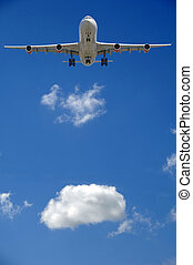 Airliner and cloud - Airliner is going to land. A white...