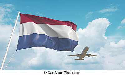 Airliner approaches the Dutch national flag. Tourism in Netherlands. 3D rendering