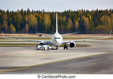 Airliner at an airport taxiway