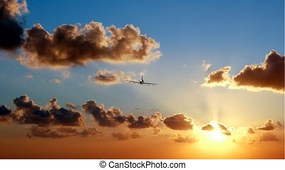 airliner at sunset