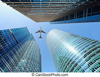 Airliner flying over skyscrapers - Airliner flying over...