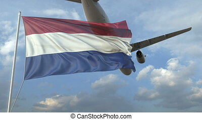 Airliner flying over waving flag of the Netherlands. 3D animation