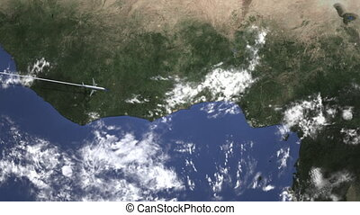 Airliner flying to Lagos, Nigeria from west on the map. ...