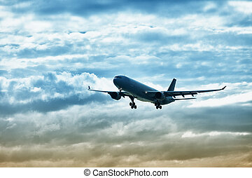 Airliner landing on evening sky