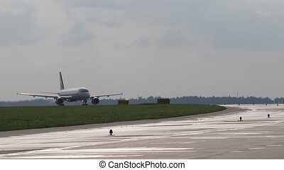 Airliner moves on runway. Takeoff run of passenger airplane