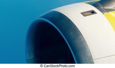 Airliner operating jet engine against blue sky. Air travel...