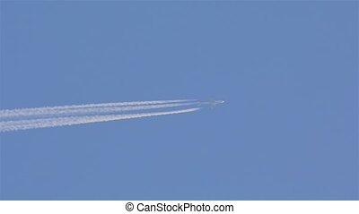 Airplain Contrail Shot - Airplain contrail going through he...