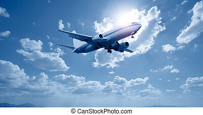 airplane - aeroplane flying on a clear blue sky