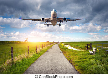 Airplane and rural road at sunset