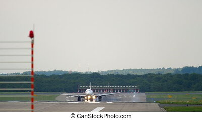 Airplane approaching and landing in Dusseldorf Airport