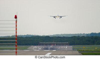 Airplane approaching before landing in Dusseldorf Airport