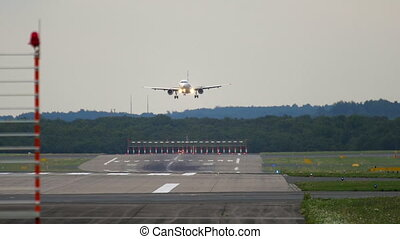 Airplane approaching before landing in Dusseldorf Airport, slow motion
