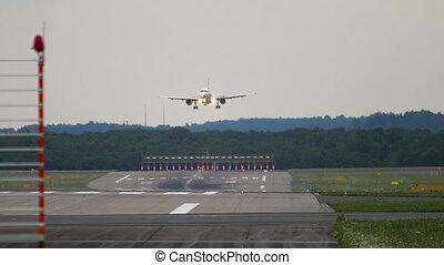 Airplane approaching before landing in Dusseldorf Airport,...
