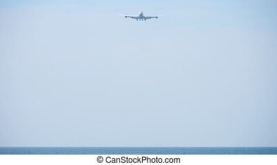 Airplane approaching before landing - Widebody four-engine...