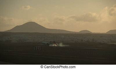 Airplane arrival to scenic coastal town - Aircraft landing...