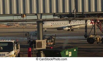 Airplane at airport runway terminal - Airport - taxiway,...